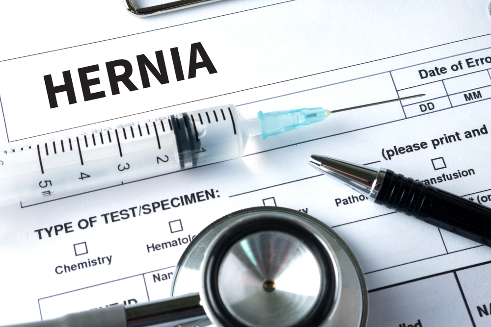 Hernia medical report with syringe and stethoscope