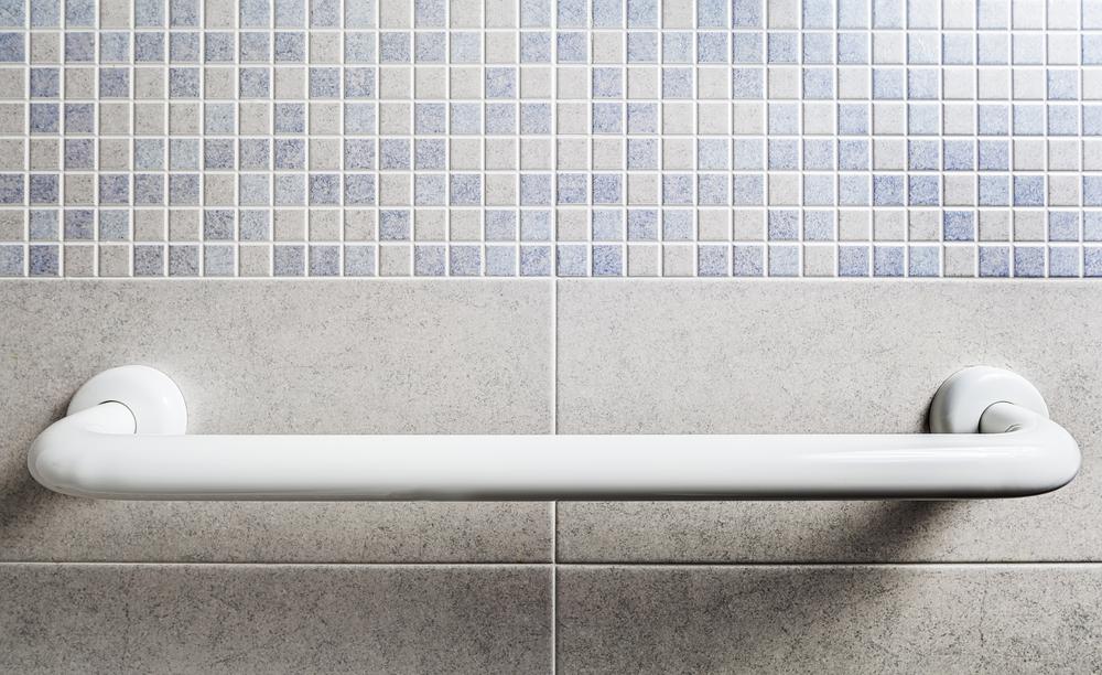 White grab handle on bathroom wall
