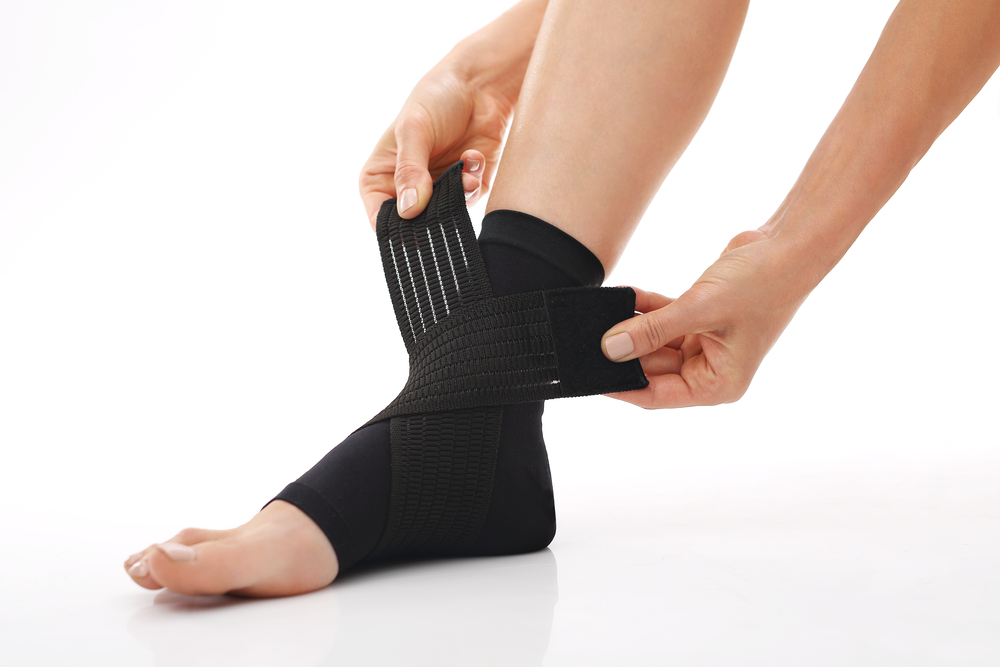 Woman putting on ankle brace